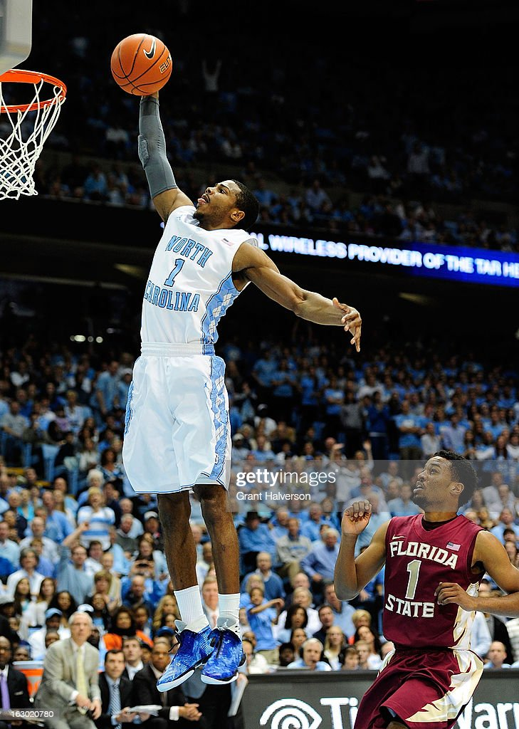 Dexter Strickland #1 of the North Carolina Tar Heels scores on a breakaway as Devon Bookert #1 the Florida State Seminoles looks on during play at Dean Smith Center on March 3, 2013 in Chapel Hill, North Carolina. North Carolina won 79-58.