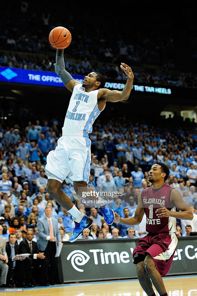<a gi-track='captionPersonalityLinkClicked' href=/galleries/search?phrase=Dexter+Strickland&family=editorial&specificpeople=5792010 ng-click='$event.stopPropagation()'>Dexter Strickland</a> #1 of the North Carolina Tar Heels scores on a breakaway as Devon Bookert #1 the Florida State Seminoles looks on during play at Dean Smith Center on March 3, 2013 in Chapel Hill, North Carolina. North Carolina won 79-58.