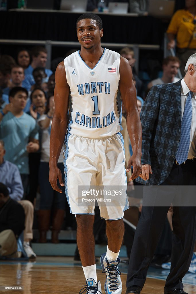 <a gi-track='captionPersonalityLinkClicked' href=/galleries/search?phrase=Dexter+Strickland&family=editorial&specificpeople=5792010 ng-click='$event.stopPropagation()'>Dexter Strickland</a> #1 of the North Carolina Tar Heels smiles during a game against the Georgia Tech Yellow Jackets on January 23, 2013 at the Dean E. Smith Center in Chapel Hill, North Carolina. North Carolina won 63-79.