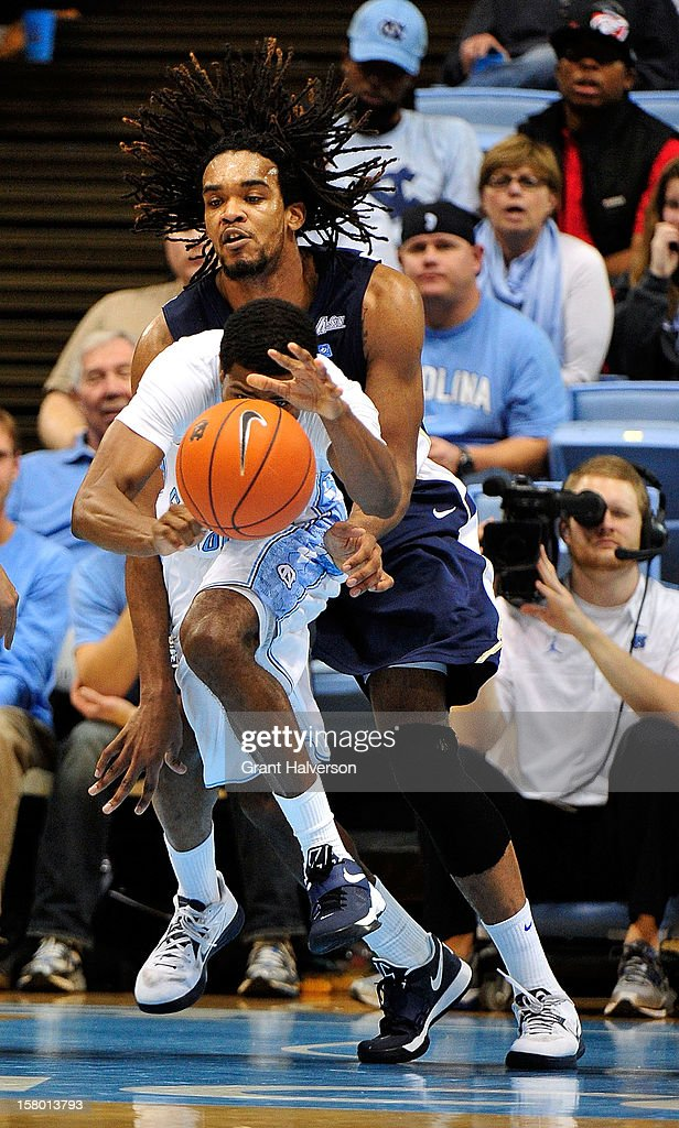 Dexter Strickland #1 of the North Carolina Tar Heels takes a loose ball away from Hunter Harris #20 of the East Tennessee State Buccaneers during play at Dean Smith Center on December 8, 2012 in Chapel Hill, North Carolina. North Carolina won 78-55.