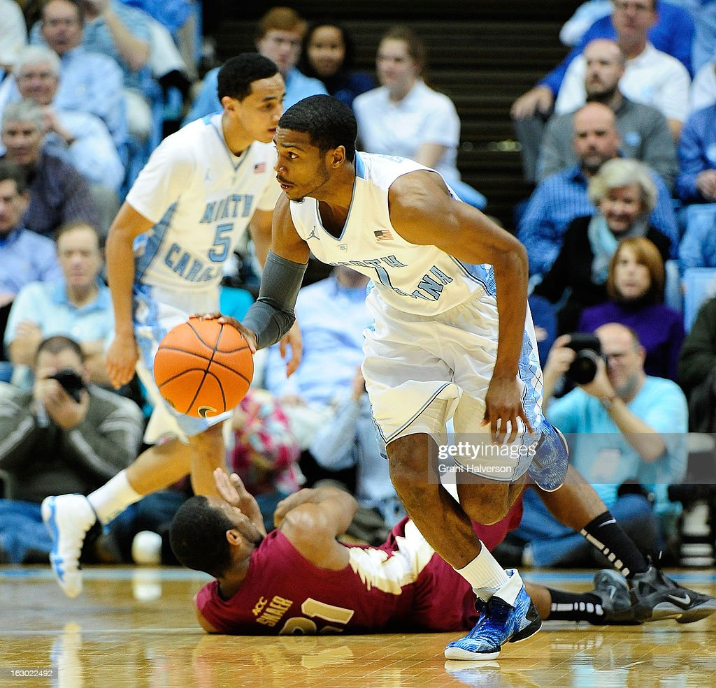 Dexter Strickland #1 of the North Carolina Tar Heels takes a loose ball away from Michael Snaer #21 of the Florida State Seminoles during play at Dean Smith Center on March 3, 2013 in Chapel Hill, North Carolina. North Carolina won 79-58.