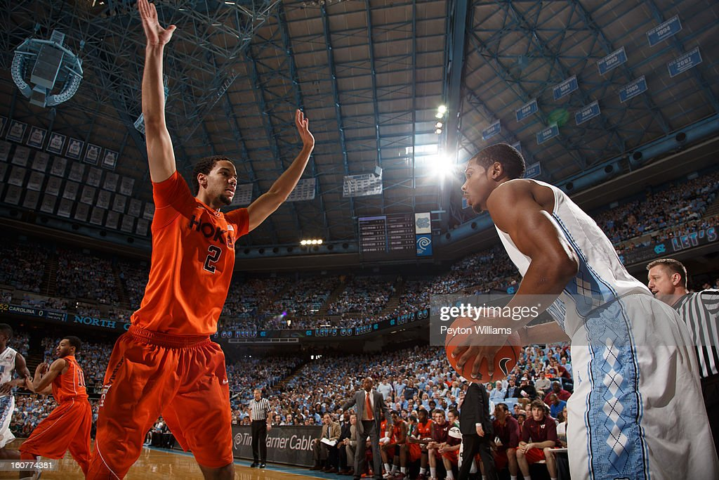 <a gi-track='captionPersonalityLinkClicked' href=/galleries/search?phrase=Dexter+Strickland&family=editorial&specificpeople=5792010 ng-click='$event.stopPropagation()'>Dexter Strickland</a> #1 of the North Carolina Tar Heels tries to pass the ball in bounds while defended by Virginia Tech Hokies forward Joey Van Zegeren #2 on February 02, 2013 at the Dean E. Smith Center in Chapel Hill, North Carolina. North Carolina won 72-60 in overtime.