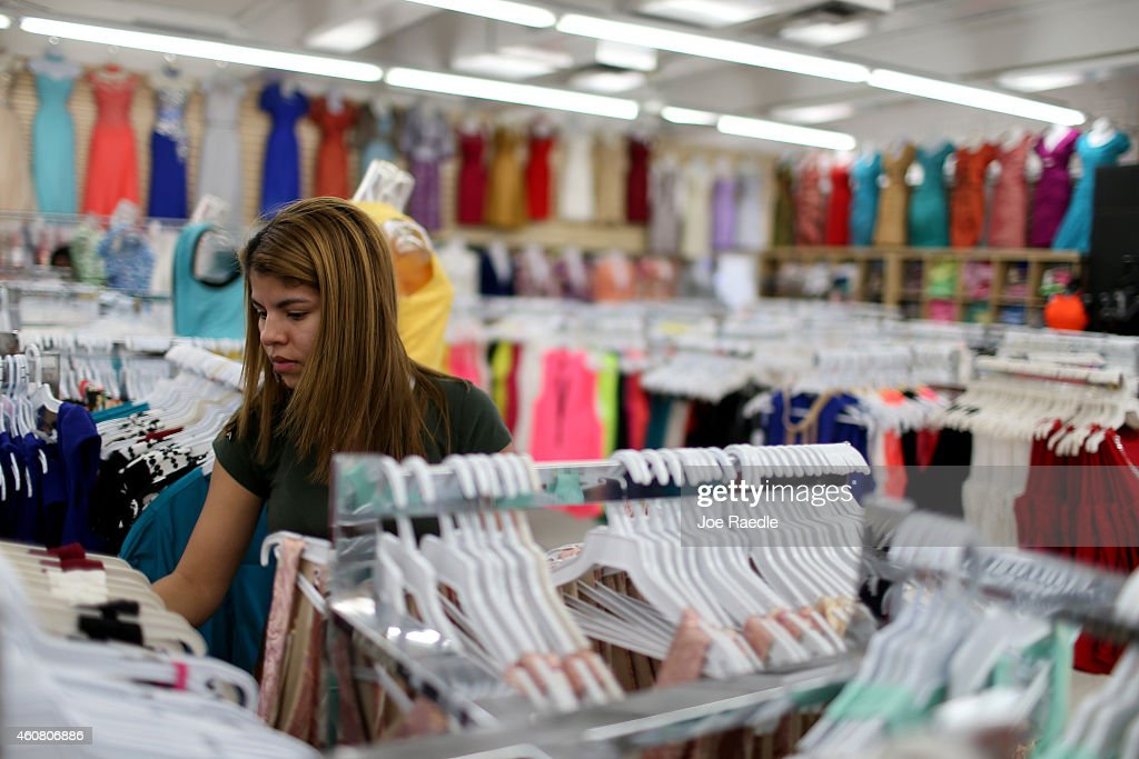 Deymi Torrez shops in the Victoria Fashion store as reports indicate that the 3rd quarter GDP was 50% revised up from last month's estimate of 39%...