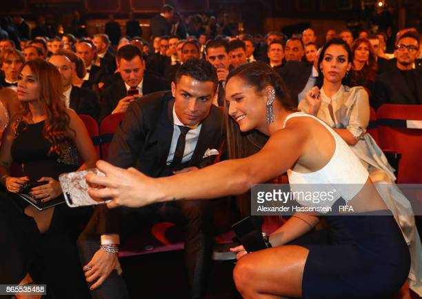 Deyna Castellanos and Cristiano Ronaldo takes a selfie during The Best FIFA Football Awards at The London Palladium on October 23 2017 in London...