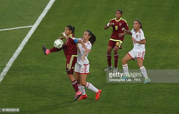 Deyna Castellanos of Venezuela battles with Berta Pujadas of Spain during the FIFA U17 Women's World Cup Jordan 2016 Third Place PlayOff match...