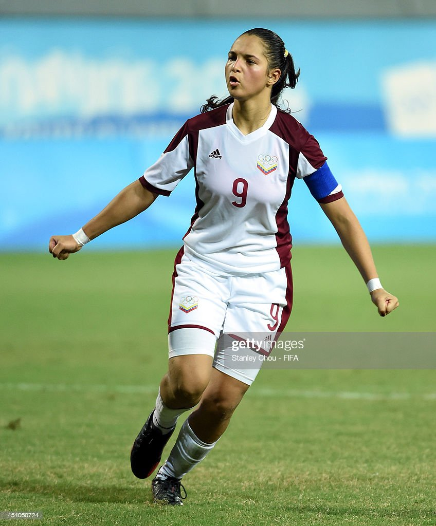 Deyna Castellanos of Venezuela celebrates after she converted the penalty during the penalty shoot out during the 2014 FIFA Girls Summer Youth Olympic Football Tournament Semi Final match between Venezuela and Mexico at Wutaishan Stadium on August 23, 2014 in Nanjing, China.