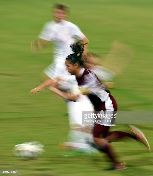 Deyna Castellanos of Venezuela competes for the ball during the FIFA Girls Summer Olympic Football Tournament Preliminary Round Group A match between...