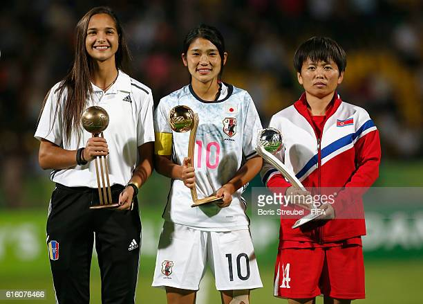 Deyna Castellanos of Venezuela Fuka Nagano of Japan and Sung Hyang Sim of Korea DPR pose with their Adidas Player of the Tournament Trophies after...