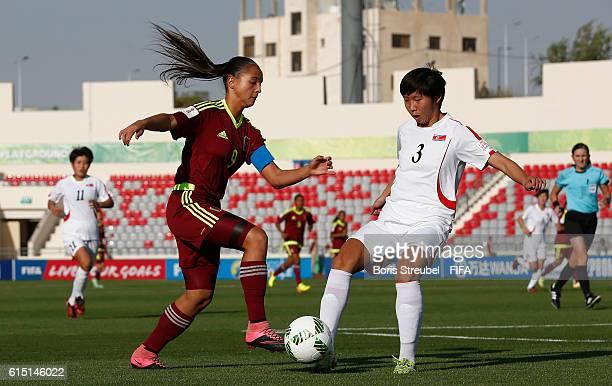 Deyna Castellanos of Venezuela is challenged by Ri Kum Hyand of Korea DPR during the FIFA U17 Women's World Cup Semi Final match between Venezuela...