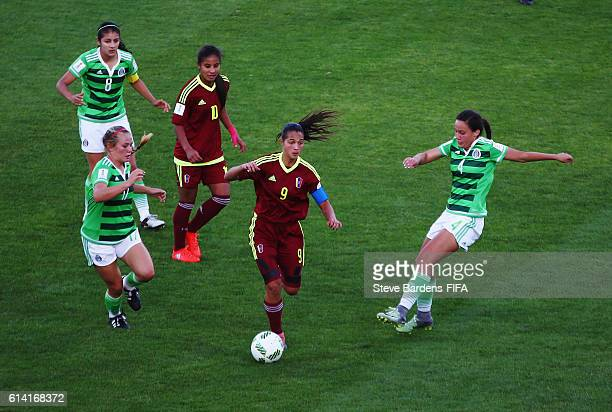Deyna Castellanos of Venezuela takes on the Mexico defence during the FIFA U17 Women's World Cup Jordan 2016 quarter final match between Mexico and...