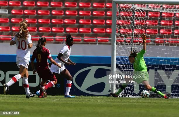 Deyna Castellanos#9 of Venezuela scores the openng goal during the FIFA U17 Women's World Cup 2014 quarter final match between Venezuela and Canada...