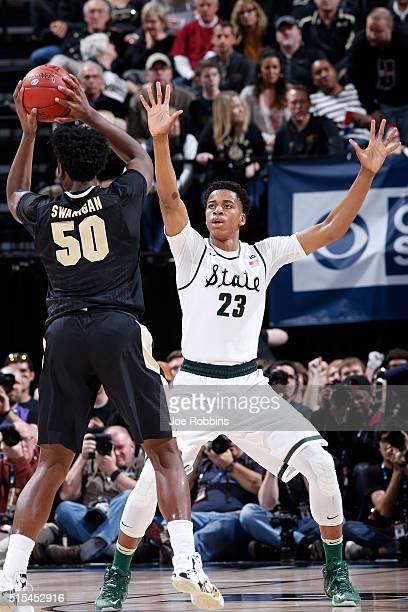 Deyonta Davis of the Michigan State Spartans defends against Caleb Swanigan of the Purdue Boilermakers in the championship game of the Big Ten...