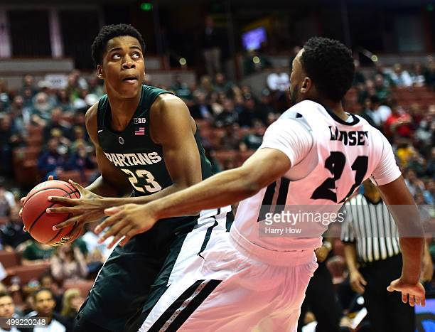 Deyonta Davis of the Michigan State Spartans prepares to shoot over a fallen Jalen Lindsey of the Providence Friars during the championship game of...
