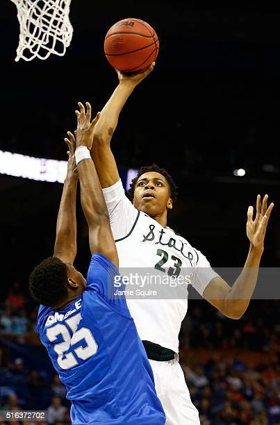 Deyonta Davis of the Michigan State Spartans shoots against Karl Gamble of the Middle Tennessee Blue Raiders in the first half during the first round...