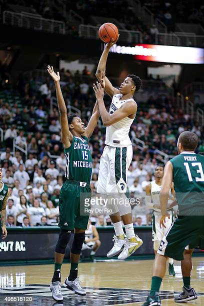 Deyonta Davis of the Michigan State Spartans shoots over Jordan Nobles of the Eastern Michigan Eagles in the second half at the Breslin Center on...