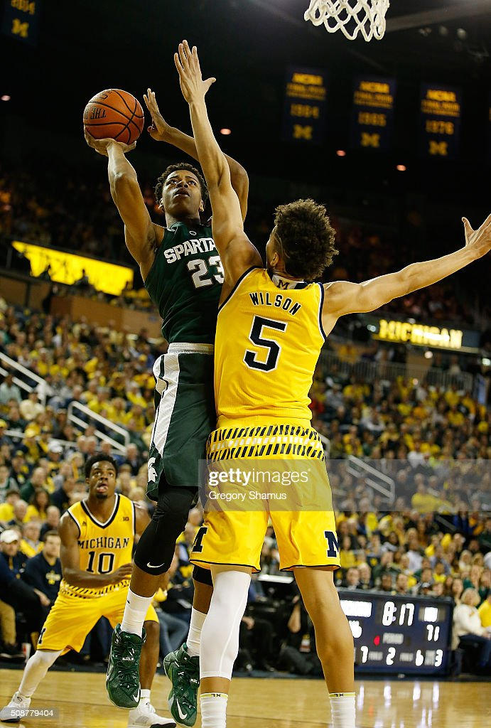 <a gi-track='captionPersonalityLinkClicked' href=/galleries/search?phrase=Deyonta+Davis&family=editorial&specificpeople=14247809 ng-click='$event.stopPropagation()'>Deyonta Davis</a> #23 of the Michigan State Spartans takes a second half shot over D.J. Wilson #5 of the Michigan Wolverines during the second half at Crisler Center on January 6, 2016 in Ann Arbor, Michigan. Michigan State won the game 89-73.