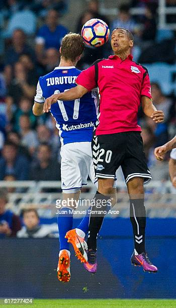 Deyverson Brum of Deportivo Alaves duels for the ball with David Zurutuza of Real Sociedad during the La Liga match between Real Sociedad de Futbol...