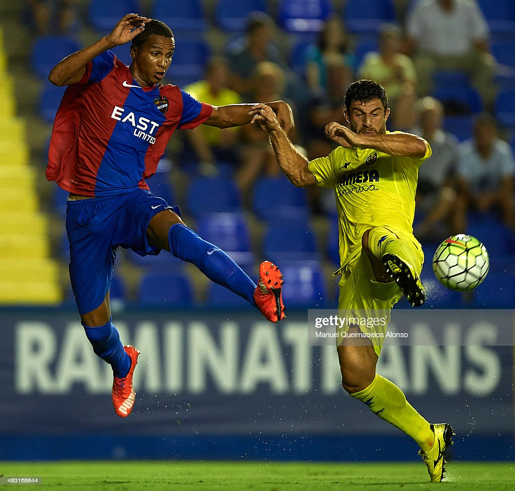 Deyverson (L) of Levante and Bojan Jokic of Villarreal battle for the ball during a Pre Season Friendly match between Levante UD and Villarreal CF at Ciutat de Valencia Stadium on August 6, 2015 in Valencia, Spain.