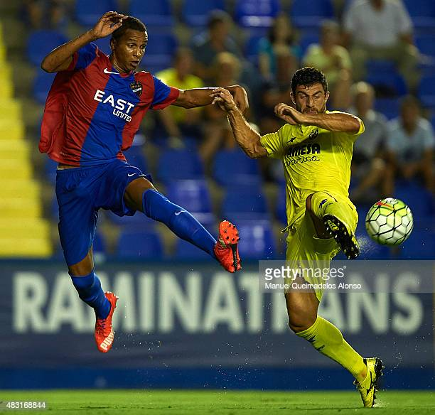 Deyverson of Levante and Bojan Jokic of Villarreal battle for the ball during a Pre Season Friendly match between Levante UD and Villarreal CF at...
