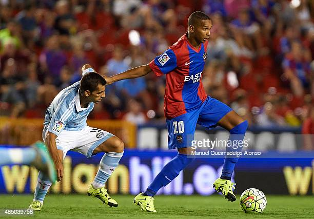 Deyverson of Levante battle for the ball with Augusto Matias Fernandez of Celta during the La Liga match between Levante UD and Real Club Celta de...