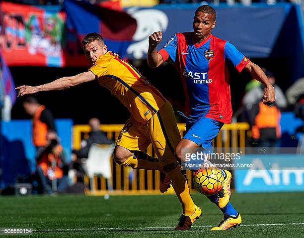 Deyverson of Levante competes for the ball with Jordi Alba of Barcelona during the La Liga match between Levante UD and FC Barcelona at Ciutat de...