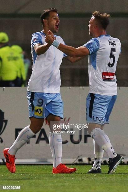 Deyvison Rogerio Da Silva of Sydney FC celebrates a goal with Jordy Buijs of Sydney FC kicks the ball during the FFA Cup Semi Final match between...