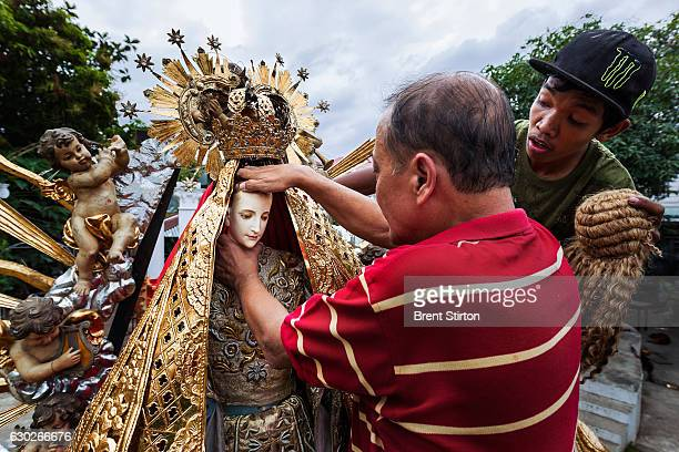 Dez Battista an expert on religious icons in the Philippines prepares his ' Nuestra Senora Reina del Ciela' Our Lady of Heaven' for a religious...