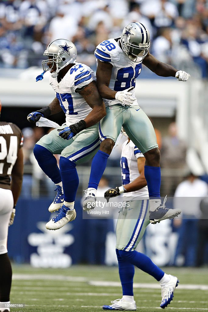 Dez Bryant #88 and Lawrence Vickers #47 of the Dallas Cowboys celebrate after a big play against the Cleveland Browns at Cowboys Stadium on November 18, 2012 in Arlington, Texas. The Cowboys defeated the Browns 23-20.
