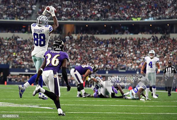 Dez Bryant catches a pass from Dak Prescott of the Dallas Cowboys during the third quarter against the Baltimore Ravens at ATT Stadium on November 20...