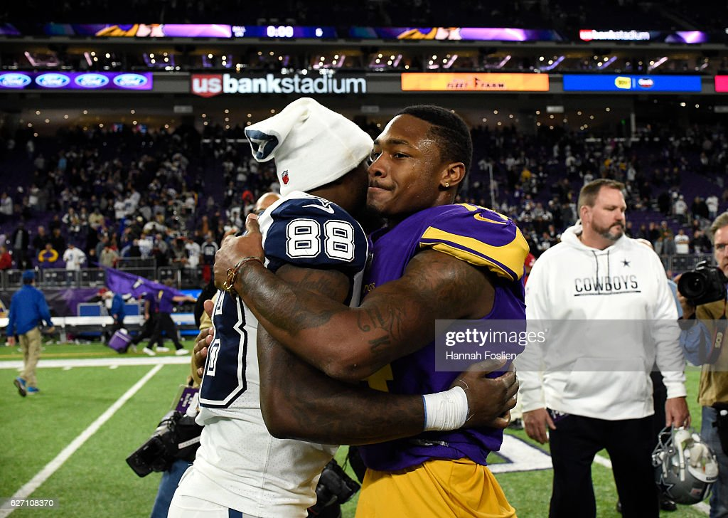 Dez Bryant #88 of the Dallas Cowboys and Stefon Diggs #14 of the Minnesota Vikings embrace after the game on December 1, 2016 at US Bank Stadium in Minneapolis, Minnesota. The Cowboys defeated the Vikings 17-15.
