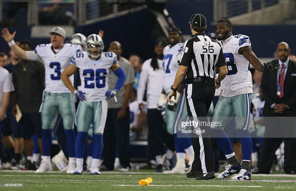 Dez Bryant of the Dallas Cowboys argues with side judge Allen Baynes after a penatly was called against Anthony Hitchens of the Dallas Cowboys when...