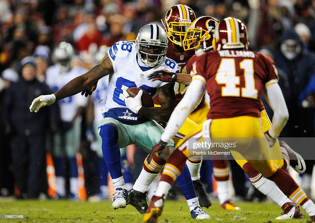 Dez Bryant #88 of the Dallas Cowboys carries a pass reception for a first down in the second quarter against the Washington Redskins at FedExField on December 30, 2012 in Landover, Maryland.