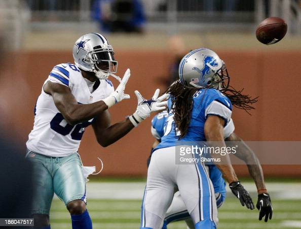Dez Bryant of the Dallas Cowboys catches a fourth quarter touchdown pass behind Rashean Mathis of the Detroit Lions at Ford Field on October 27 2013...