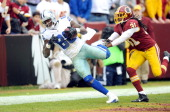 Dez Bryant of the Dallas Cowboys catches a touchdown in the second quarter against the Washington Redskins at FedExField on December 22 2013 in...