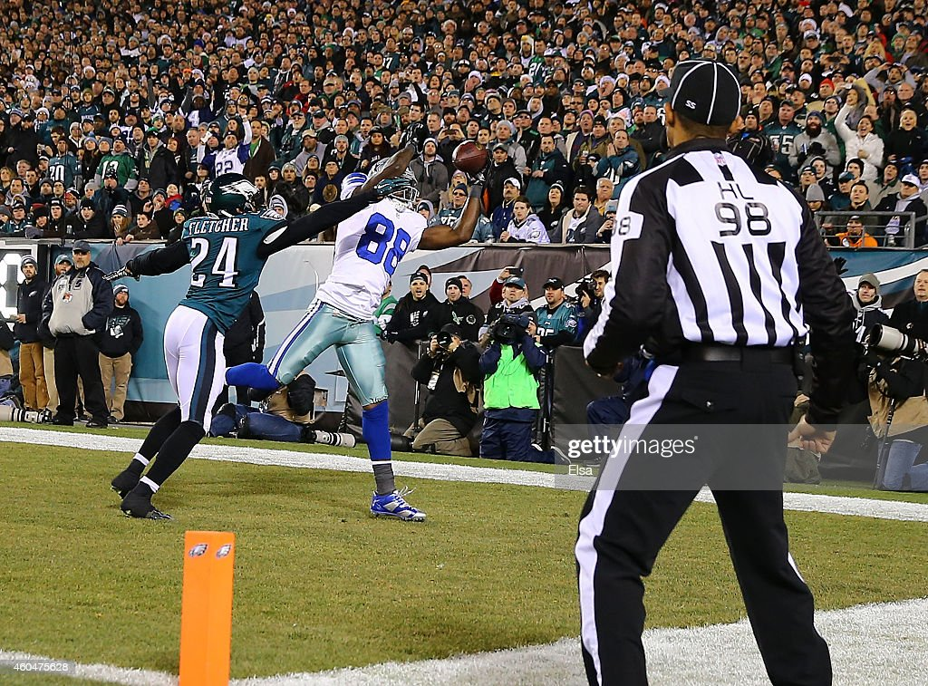 Dez Bryant #88 of the Dallas Cowboys catches a touchdown over Bradley Fletcher #24 of the Philadelphia Eagles in the first quarter at Lincoln Financial Field on December 14, 2014 in Philadelphia, Pennsylvania.