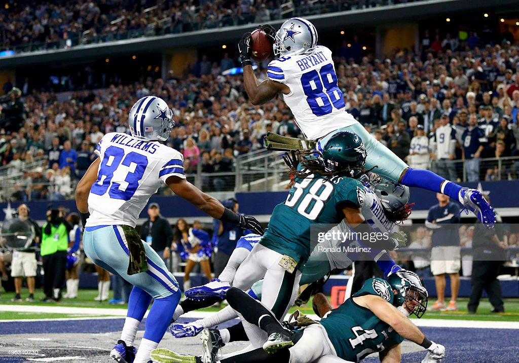 <a gi-track='captionPersonalityLinkClicked' href=/galleries/search?phrase=Dez+Bryant&family=editorial&specificpeople=4480158 ng-click='$event.stopPropagation()'>Dez Bryant</a> #88 of the Dallas Cowboys catches a touchdown pass against <a gi-track='captionPersonalityLinkClicked' href=/galleries/search?phrase=E.J.+Biggers&family=editorial&specificpeople=5837801 ng-click='$event.stopPropagation()'>E.J. Biggers</a> #38 of the Philadelphia Eagles as teammate <a gi-track='captionPersonalityLinkClicked' href=/galleries/search?phrase=Terrance+Williams+-+American+Football+Player&family=editorial&specificpeople=11331054 ng-click='$event.stopPropagation()'>Terrance Williams</a> #83 looks on in the fourth quarter at AT&T Stadium on November 8, 2015 in Arlington, Texas.