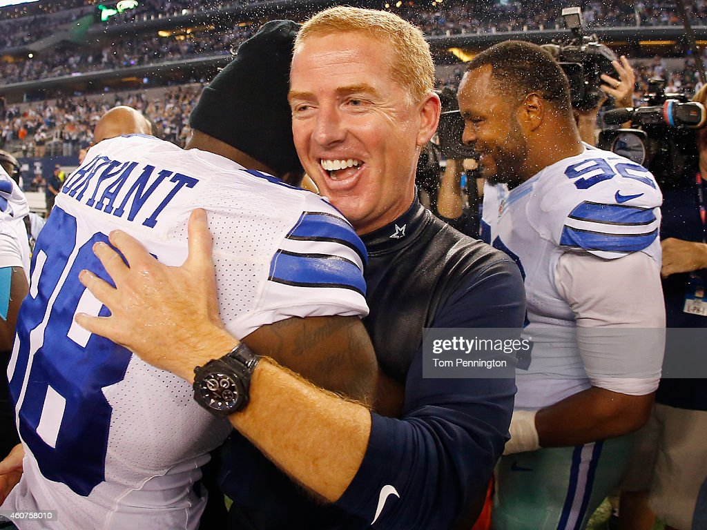 Dez Bryant #88 of the Dallas Cowboys celebrates with head coach Jason Garrett of the Dallas Cowboys after the Cowboys beat the Colts 42-7 at AT&T Stadium on December 21, 2014 in Arlington, Texas.