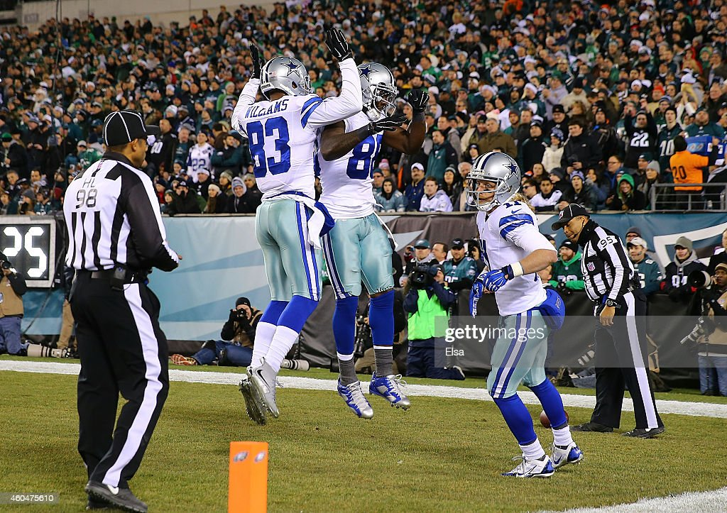 Dez Bryant #88 of the Dallas Cowboys celebrates with Terrance Williams #83 after scoring a touchdown in the first quarter against the Philadelphia Eagles at Lincoln Financial Field on December 14, 2014 in Philadelphia, Pennsylvania.