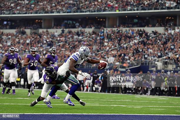 Dez Bryant of the Dallas Cowboys dives for the end zone to score a touchdown after catching a pass from Dak Prescott during the third quarter against...