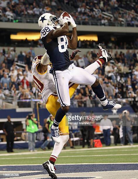 Dez Bryant of the Dallas Cowboys drops a pass in the endzone against Cedric Griffin and Madieu Williams of the Washington Redskins during a...