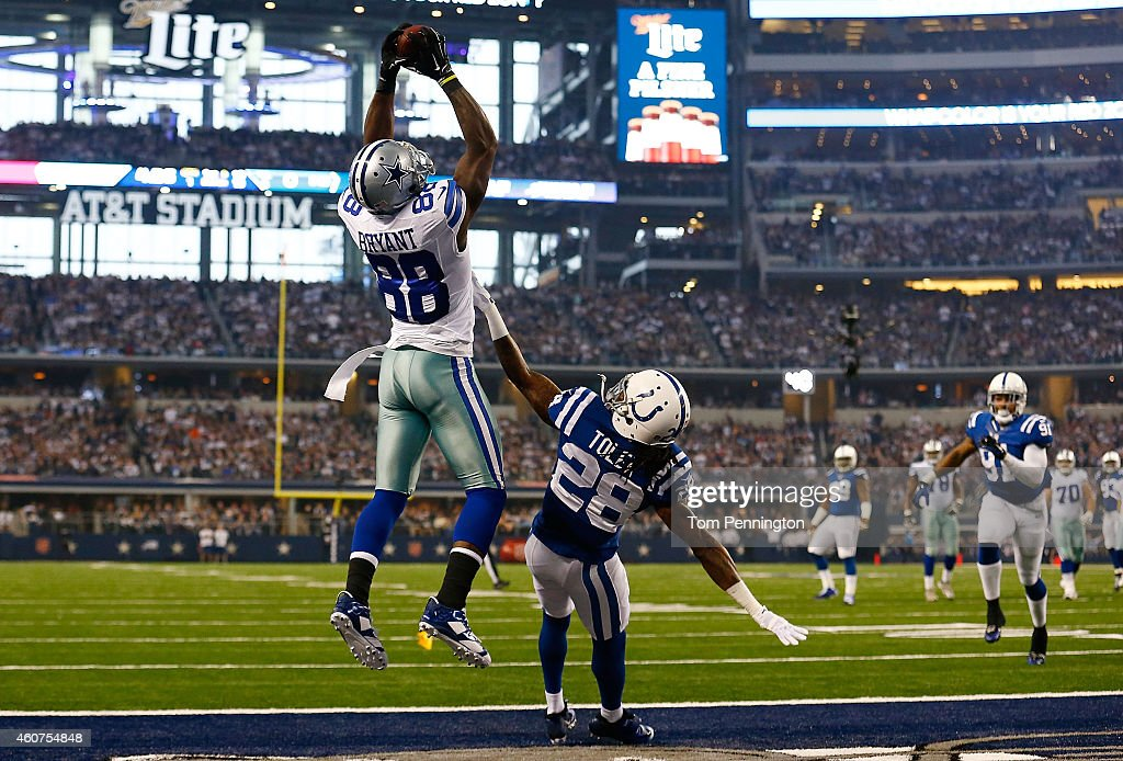 <a gi-track='captionPersonalityLinkClicked' href=/galleries/search?phrase=Dez+Bryant&family=editorial&specificpeople=4480158 ng-click='$event.stopPropagation()'>Dez Bryant</a> #88 of the Dallas Cowboys goes up for the catch to score a touchdown as <a gi-track='captionPersonalityLinkClicked' href=/galleries/search?phrase=Greg+Toler&family=editorial&specificpeople=5838089 ng-click='$event.stopPropagation()'>Greg Toler</a> #28 of the Indianapolis Colts defends in the first half at AT&T Stadium on December 21, 2014 in Arlington, Texas.