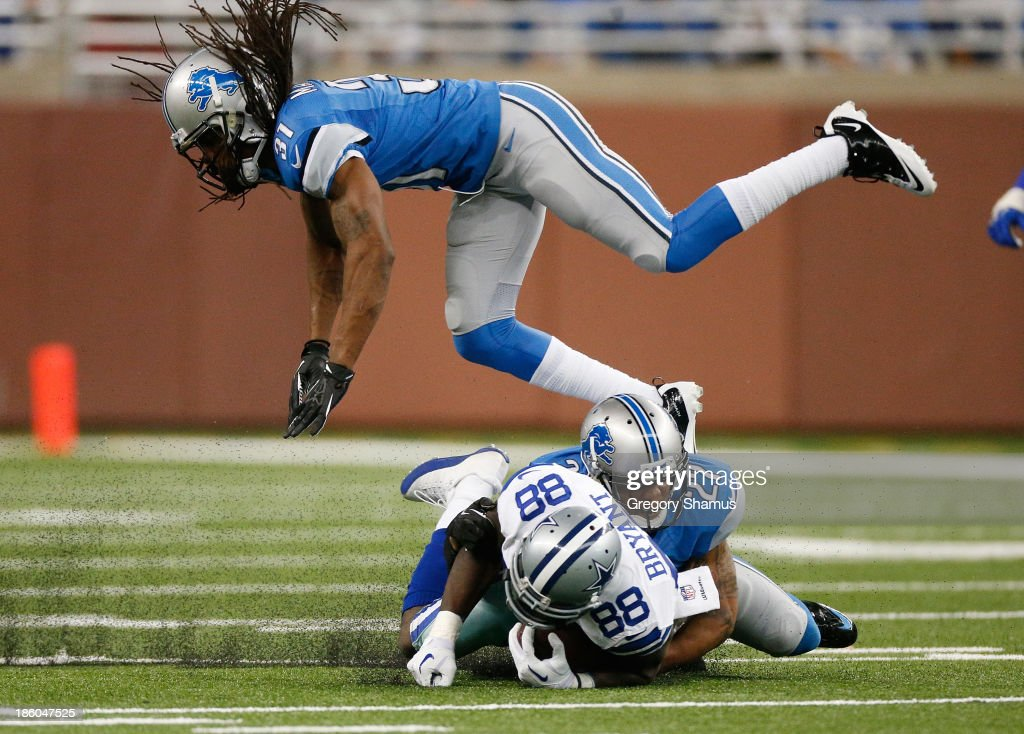 <a gi-track='captionPersonalityLinkClicked' href=/galleries/search?phrase=Dez+Bryant&family=editorial&specificpeople=4480158 ng-click='$event.stopPropagation()'>Dez Bryant</a> #88 of the Dallas Cowboys is tackled after a third quarter catch by <a gi-track='captionPersonalityLinkClicked' href=/galleries/search?phrase=Glover+Quin&family=editorial&specificpeople=5732643 ng-click='$event.stopPropagation()'>Glover Quin</a> #27 and <a gi-track='captionPersonalityLinkClicked' href=/galleries/search?phrase=Rashean+Mathis&family=editorial&specificpeople=2097176 ng-click='$event.stopPropagation()'>Rashean Mathis</a> #31 of the Detroit Lions at Ford Field on October 27, 2013 in Detroit, Michigan. Detroit won the game 31-30.