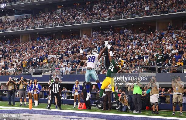 Dez Bryant of the Dallas Cowboys jumps for a pass against Davon House of the Green Bay Packers at ATT Stadium on October 8 2017 in Arlington Texas