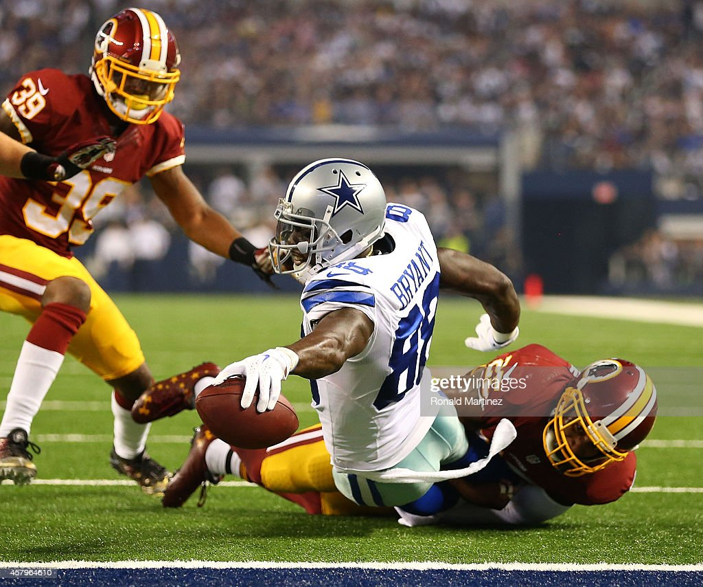 Dez Bryant of the Dallas Cowboys lunges for a touchdown against Ryan Clark of the Washington Redskins during the first half at ATT Stadium on October...