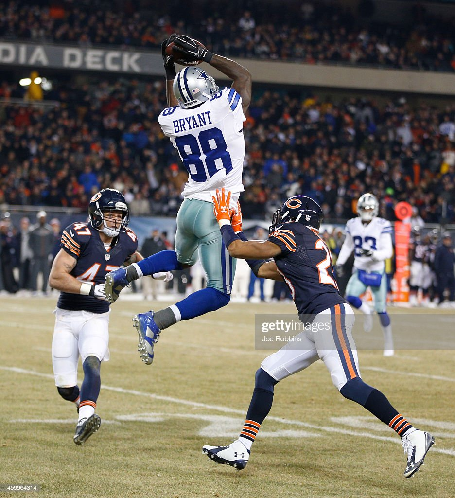Dez Bryant of the Dallas Cowboys makes a catch between Chris Conte of the Chicago Bears and Kyle Fuller of the Chicago Bears during the third quarter...