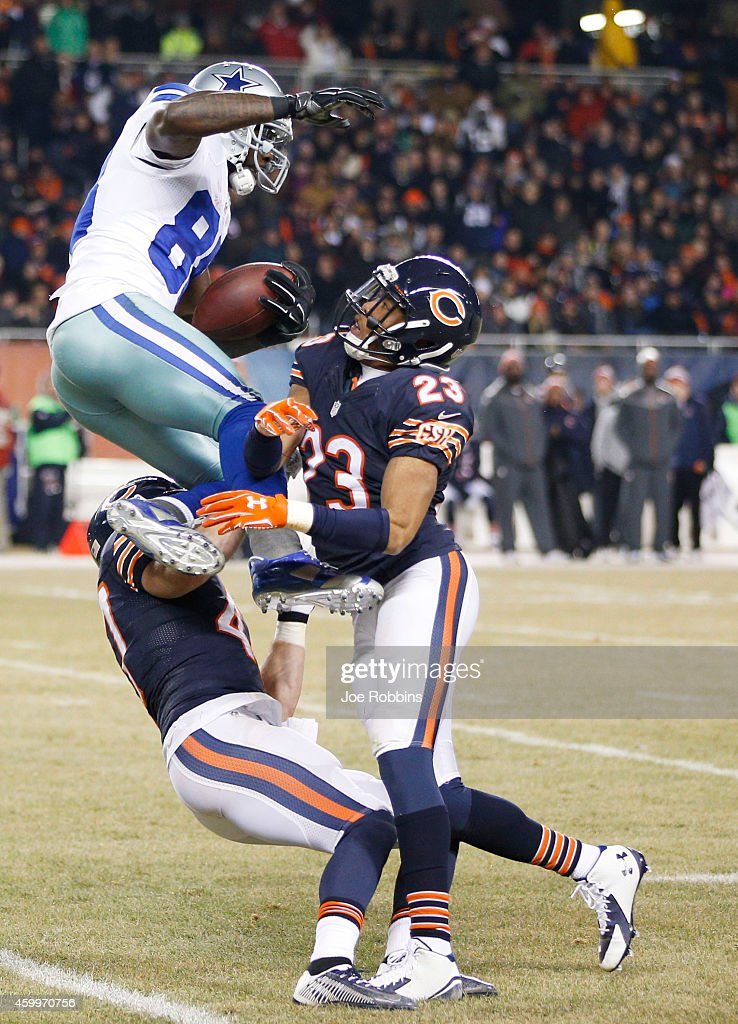 Dez Bryant #88 of the Dallas Cowboys makes a catch between Chris Conte #47 of the Chicago Bears and Kyle Fuller #23 of the Chicago Bears during the third quarter at Soldier Field on December 4, 2014 in Chicago, Illinois. The Cowboys defeated the Bears 41-28.