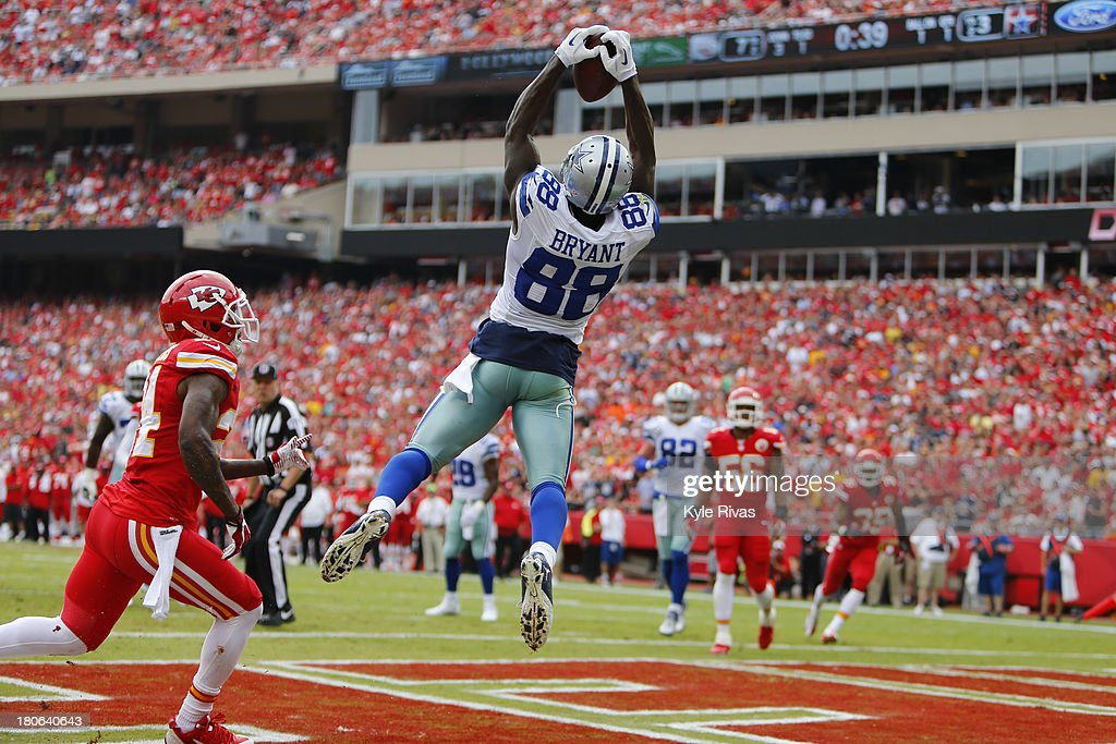 <a gi-track='captionPersonalityLinkClicked' href=/galleries/search?phrase=Dez+Bryant&family=editorial&specificpeople=4480158 ng-click='$event.stopPropagation()'>Dez Bryant</a> #88 of the Dallas Cowboys makes a leaping touchdown catch past Brandon Flowers #24 of the Kansas City Chiefs in the first quarter September 15, 2013 at Arrowhead Stadium in Kansas City, Missouri.