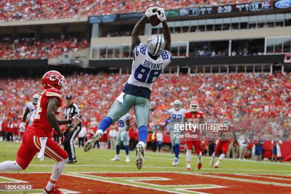 Dez Bryant of the Dallas Cowboys makes a leaping touchdown catch past Brandon Flowers of the Kansas City Chiefs in the first quarter September 15...