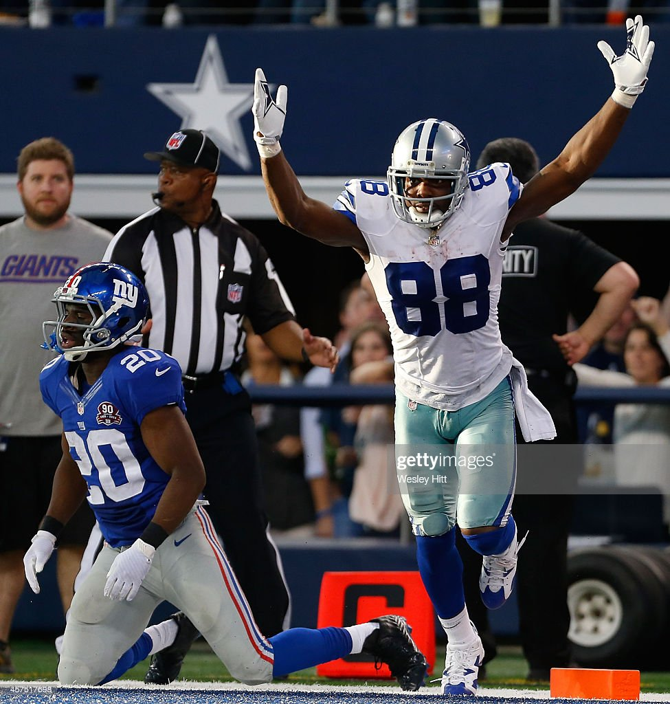 <a gi-track='captionPersonalityLinkClicked' href=/galleries/search?phrase=Dez+Bryant&family=editorial&specificpeople=4480158 ng-click='$event.stopPropagation()'>Dez Bryant</a> #88 of the Dallas Cowboys reacts after scoring a touchdown as <a gi-track='captionPersonalityLinkClicked' href=/galleries/search?phrase=Prince+Amukamara&family=editorial&specificpeople=6357867 ng-click='$event.stopPropagation()'>Prince Amukamara</a> #20 of the New York Giants is near in the second half at AT&T Stadium on October 19, 2014 in Arlington, Texas.