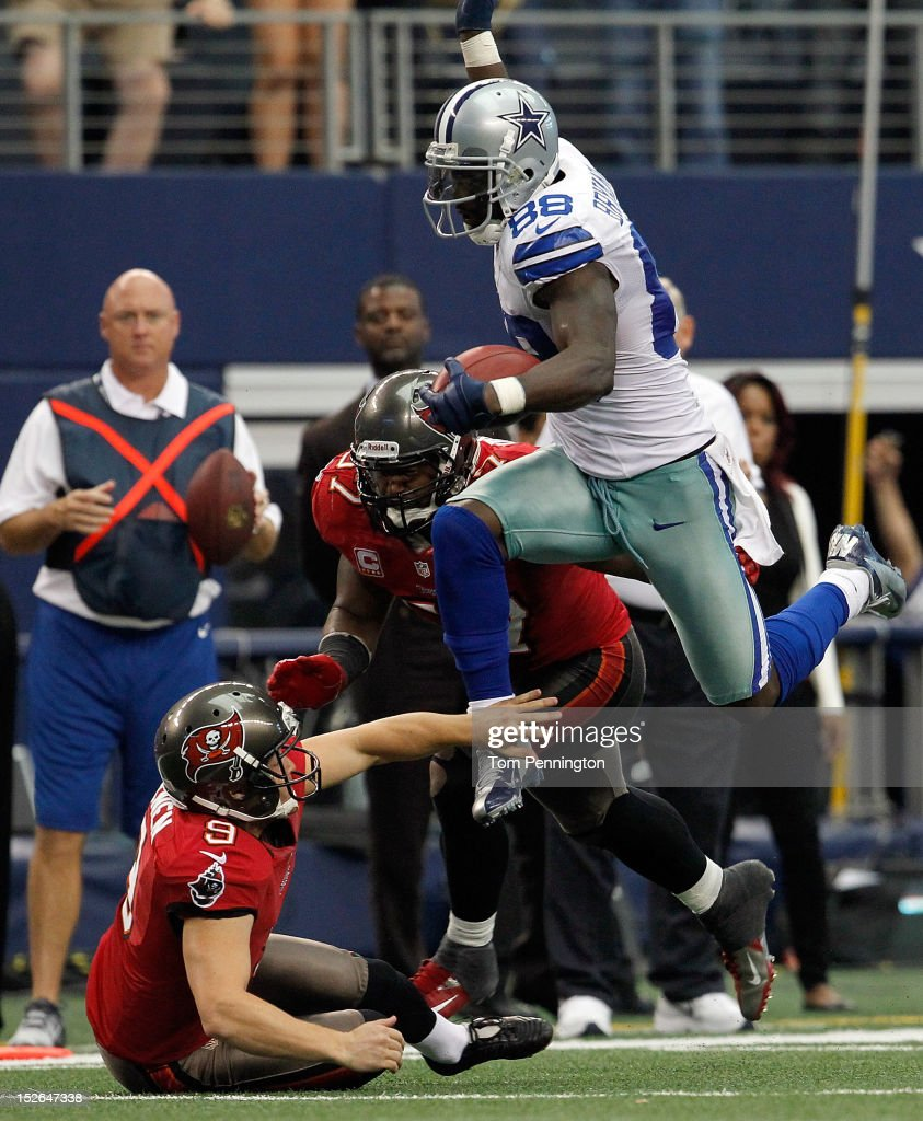 <a gi-track='captionPersonalityLinkClicked' href=/galleries/search?phrase=Dez+Bryant&family=editorial&specificpeople=4480158 ng-click='$event.stopPropagation()'>Dez Bryant</a> #88 of the Dallas Cowboys returns a punt against Adam Hayward #57 and Michael Koenen #9 of the Tampa Bay Buccaneers at Cowboys Stadium on September 23, 2012 in Arlington, Texas. The Dallas Cowboys beat the Tampa Bay Buccaneers 16-10.